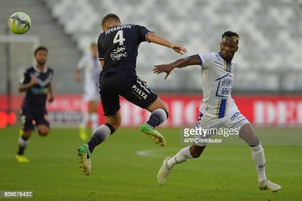 Bordeaux's Serbian defender Vukasin Jovanovic vies with Troyes' Malian forward Adama Niane during the French Ligue 1 football match between Bordeaux...