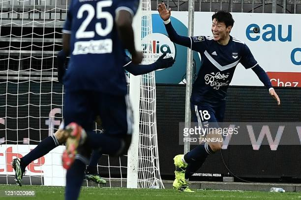 Bordeaux's South Korean forward Hwang Ui-Jo celebrates after scoring a goal during the French L1 football match between Brest and Bordeaux at the...