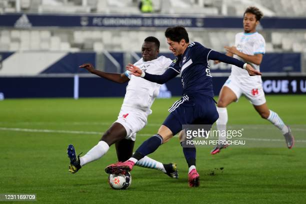 Bordeaux's South Korean forward Hwang Ui-Jo fights for the ball with Marseille's French midfielder Pape Gueye during the French L1 football match...