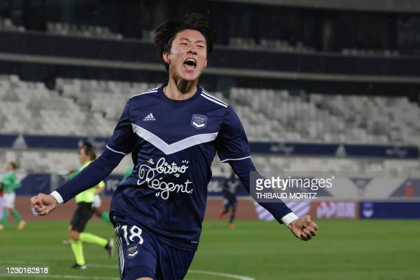 Bordeaux's South Korean forward Ui-Jo Hwang celebrates after scoring a goal during the French L1 football match between Girondins de Bordeaux and AS...