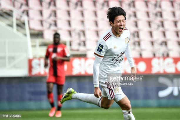 Bordeaux's South Korean forward Ui-Jo Hwang celebrates after scoring a goal during the French L1 football match Dijon vs Bordeaux on March 14 at the...