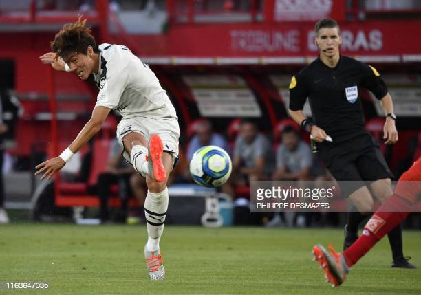 Bordeaux's South Korean midfielder UiJo Hwang shoots and scores during the French L1 football match between Dijon FCO and FC Girondins de Bordeaux on...
