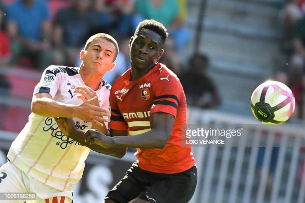 Bordeaux's Spanish defender Sergi Palencia vies with Rennes' French forward Jordan Siebatcheu during the French L1 football match Rennes vs Bordeaux,...