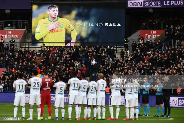 Bordeaux's team players observ a minute of silence for late Nantes' Argentinian forward Emiliano Sala whose flight disappeared from radar over the...