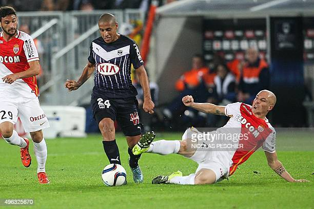 Bordeaux's Tunisian midfielder Wahbi Khazri evades Monaco's Italian defender Andrea Raggi during the French L1 football match Bordeaux vs Monaco at...