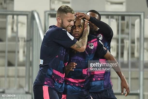 Bordeaux's Uruguyan forward Diego Rolan is congratulated by teammates after scoring a goal during the French L1 football match between Bordeaux and...