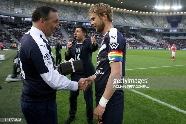 Bordeaux's US owner Joe Da Grosa gives a gift to Bordeaux's Czech midfielder Jaroslav Plasil prior to the French L1 football match between Bordeaux...