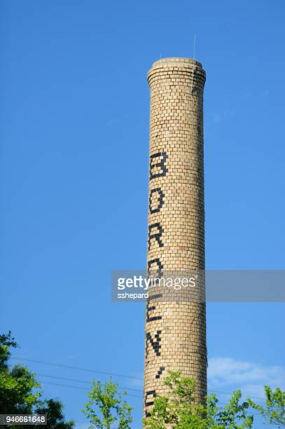 borden's sign on brick smoke stack - borden dairy stock pictures, royalty-free photos & images