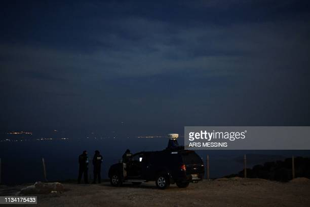 EU border agency FRONTEX members examine and scan the area between the Greek island of Lesbos and Turkey with thermal cameras on March 20 in Mytilene...