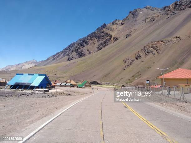 """border between chile and argentina known as """"complejo fronterizo los libertadores"""" in the andes - libertadores stock pictures, royalty-free photos & images"""