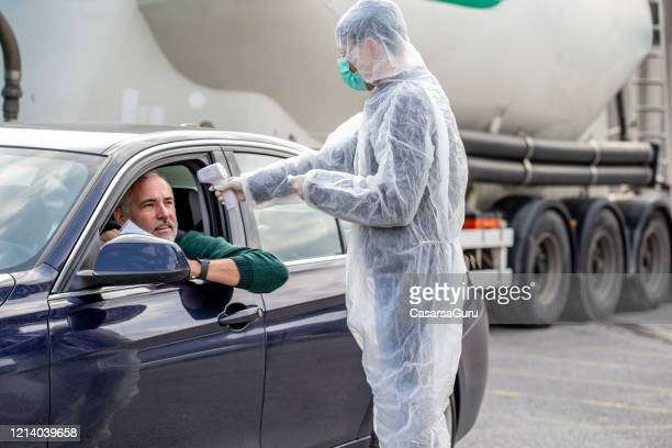 border control with body ir temperature measurement - infrared thermometer stock pictures, royalty-free photos & images