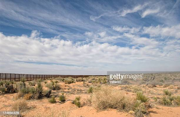 border fence in the desert - national border stock pictures, royalty-free photos & images
