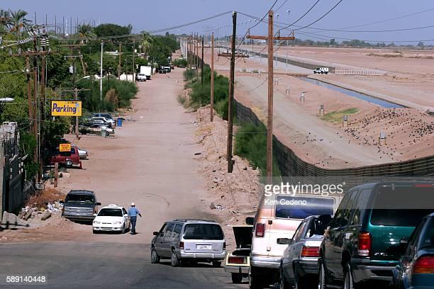 A border fence separating Mexico and the United States near Yuma Arizona as seen from the Mexico side | Location near Yuma Arizona USA
