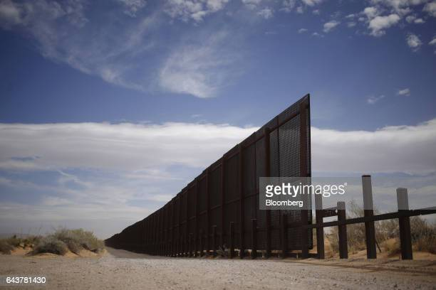 A border fence that separates the US and Mexico stands in Santa Teresa New Mexico US on Friday Feb 17 2017 The Trump administration outlined a...