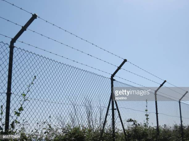Border fence wall against illegal immigration