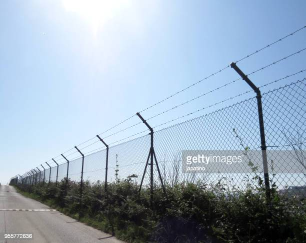 border fence wall against illegal immigration - ceuta fotografías e imágenes de stock