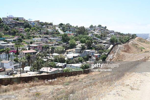 Border fences between Tijuana and San Diego, California. The are between the two fences is patrolled by US Border Patrol. It is often the site of...
