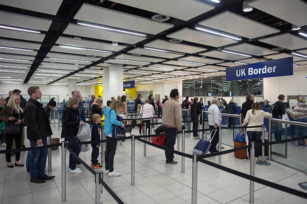Passport control at gatwick airport photos and images getty images - London immigration office ...