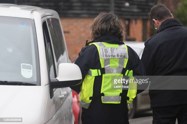 Border Force officer fills in paperwork after stopping a group of men on January 07 2019 in Lydd England A small boat was found on the beach near...