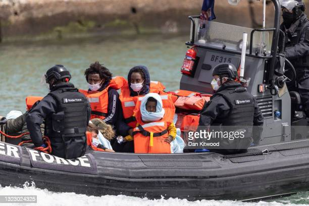 Border Force officials arrive in the port after picking up migrants in the English Channel on June 11, 2021 in Dover, England. More than 500 migrants...
