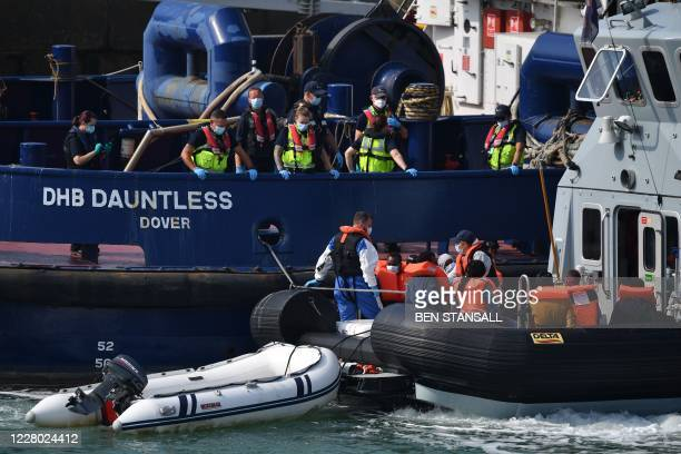 Border Force officials transfer migrants intercepted whilst travelling in a RIB from France to Dover from a Patrol Vessel to the Border Force cutter...