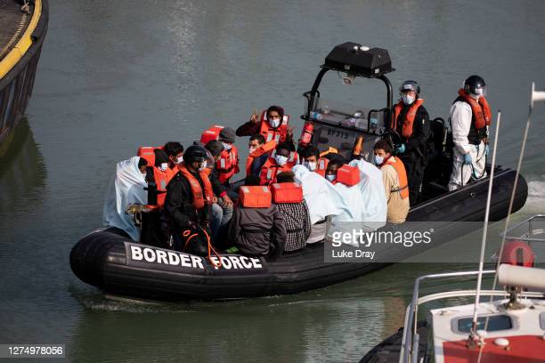 Border Force officials unload migrants, that have been intercepted in the English Channel, in order to process them on September 22, 2020 in Dover,...