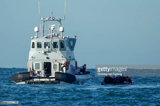 Border Force Patrol cutter 'Hunter' rescues nine migrants in a dinghy with a failed engine as they drift in the English Channel on September 06 2020...