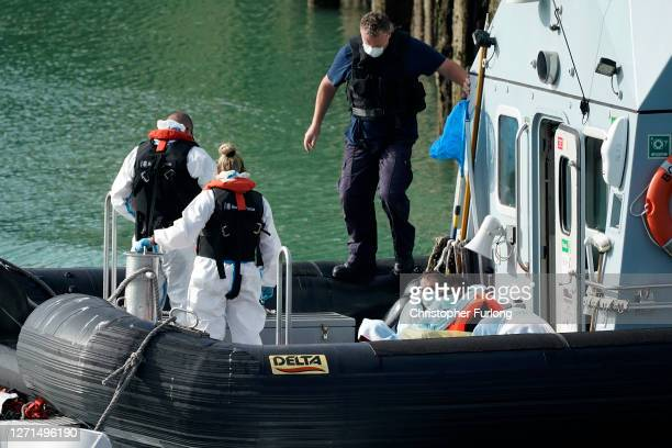 Border Force Patrol cutter 'Speedwell' disembarks four migrants at Dover port after being rescued in the English Channel on September 09 2020 in...