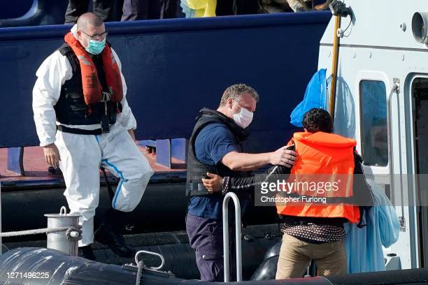 Border Force Patrol cutter 'Speedwell' disembarks four migrants at Dover port after being rescued in the English Channel on September 09, 2020 in...
