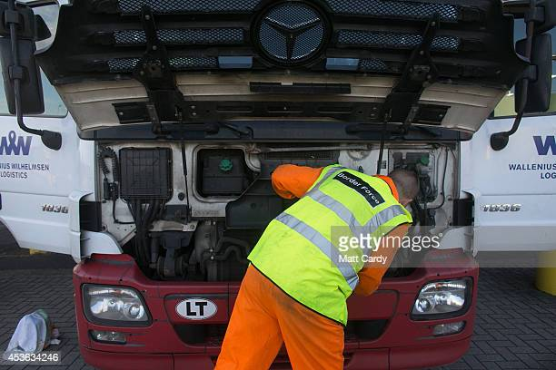 Border Force staff check inside a lorry as it arrives at the UK border after leaving a crosschannel ferry on August 13 2014 in Portsmouth England...