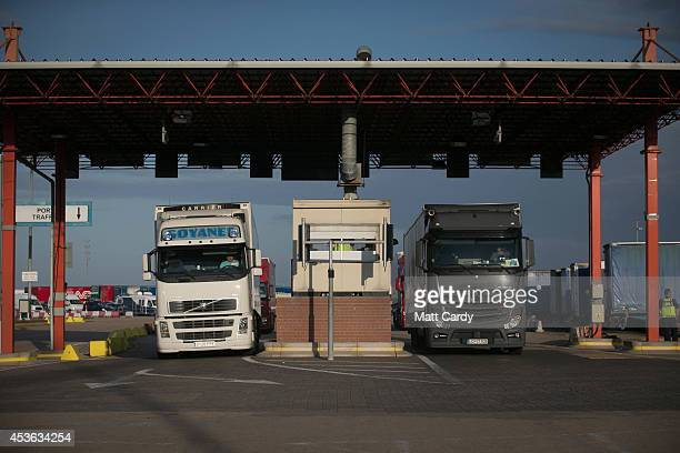 Border Force staff check lorries and trucks arriving at the UK border as they leave a cross-channel ferry that has just arrived from France on August...