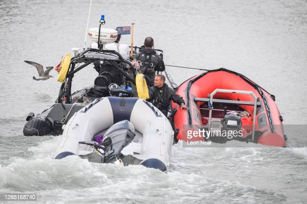 Border Force tow two inflatable ribs after intercepting a group of migrants as they attempted to cross the English Channel from France on August 11,...