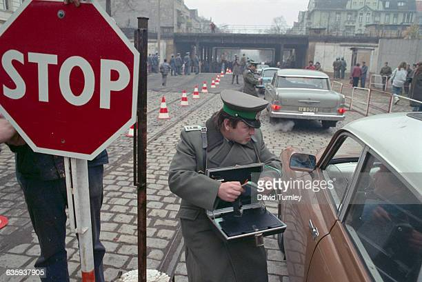 Border Guard Checking Passports