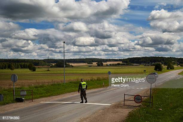A border guard controls vehicles leaving the Salcinikai region on August 18 2016 in Salcinikai Lithuania The Lithuanian region is surrounded by...