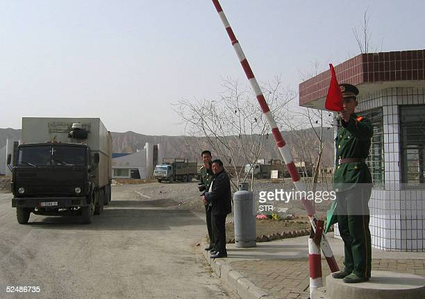 Border guards at Torugart Pass check point inspect trucks preparing to make their way to Bishkek, capital of troubled Kyrgyzstan, 28 March 2005, in...