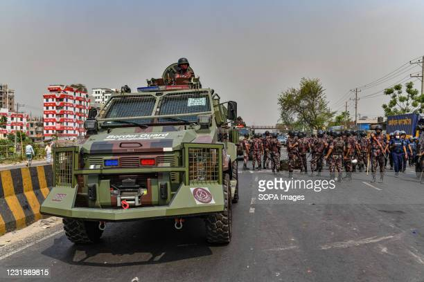 Border Guards Bangladesh personnel march towards the Hefazat-e Islam activists as they block the road during the demonstration. Hefazat-e Islam...