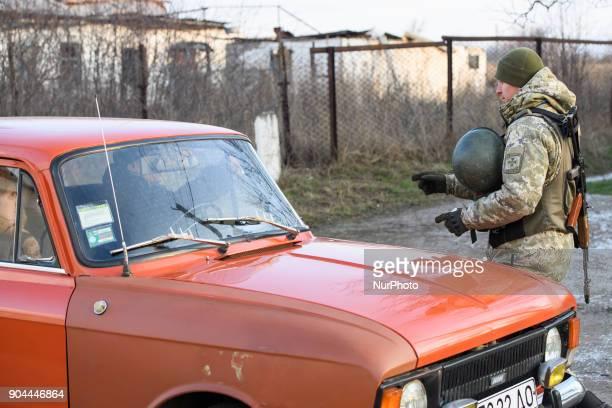 Border guards checks the car on Checkpoint quotHnutovequot in Hnutove village near Mariupol Ukraine on 12 January 2018