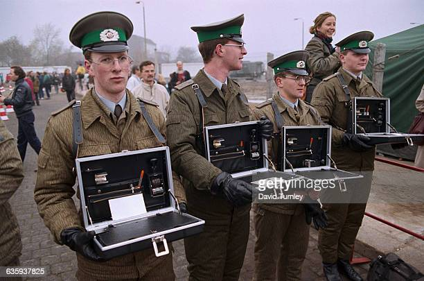Border Guards Holding Briefcases