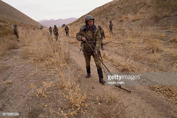 Border guards of the exUSSR conduct minesweep training near Takhta Bazar on the border between Turkmenistan and Afghanistan