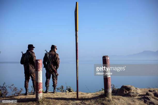 Border guards stand near the edge of the Naf river which separates Myanmar from Bangladesh is seen on February 6 2017 in Teknaf Bangladesh The United...