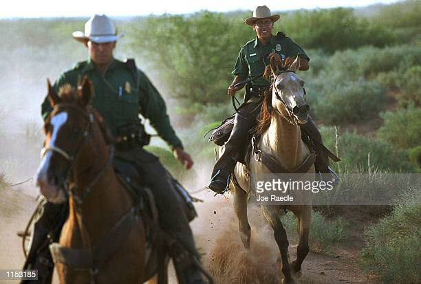 US Border horse patrol agents from the El Paso Texas sector ride alongside the guarded US border September 10 1999 They are part of a group of 18...