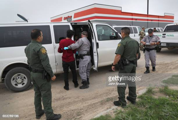 S border officials detain an undocumented immigrant caught near the USMexico border on March 13 2017 in Roma Texas The Border Patrol has reported...