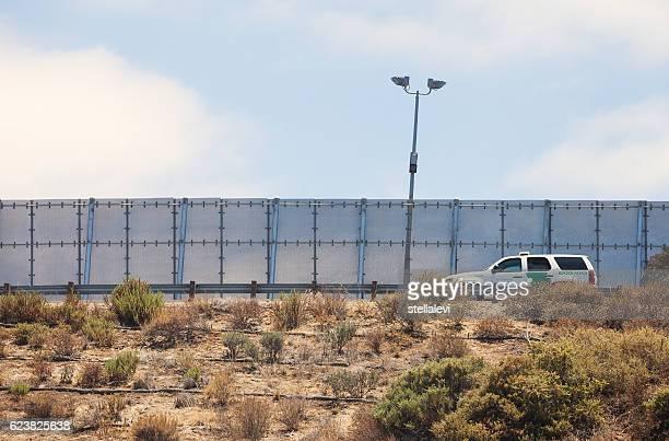 Border Partol driving along the US Mexico border