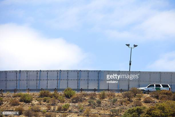 border partol driving along the us mexico border wall - mexico border wall stock pictures, royalty-free photos & images