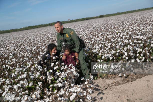 Border Patrol agent Carlos Ruiz apprehends a mother and daughter from Ecuador on September 10, 2019 in Penitas, Texas. The undocumented immigrants...