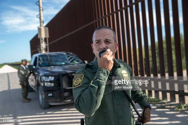 Border Patrol agent Carlos Ruiz spots a pair of undocumented immigrants while coordinating with active duty U.S. Army soldiers near the U.S.-Mexico...