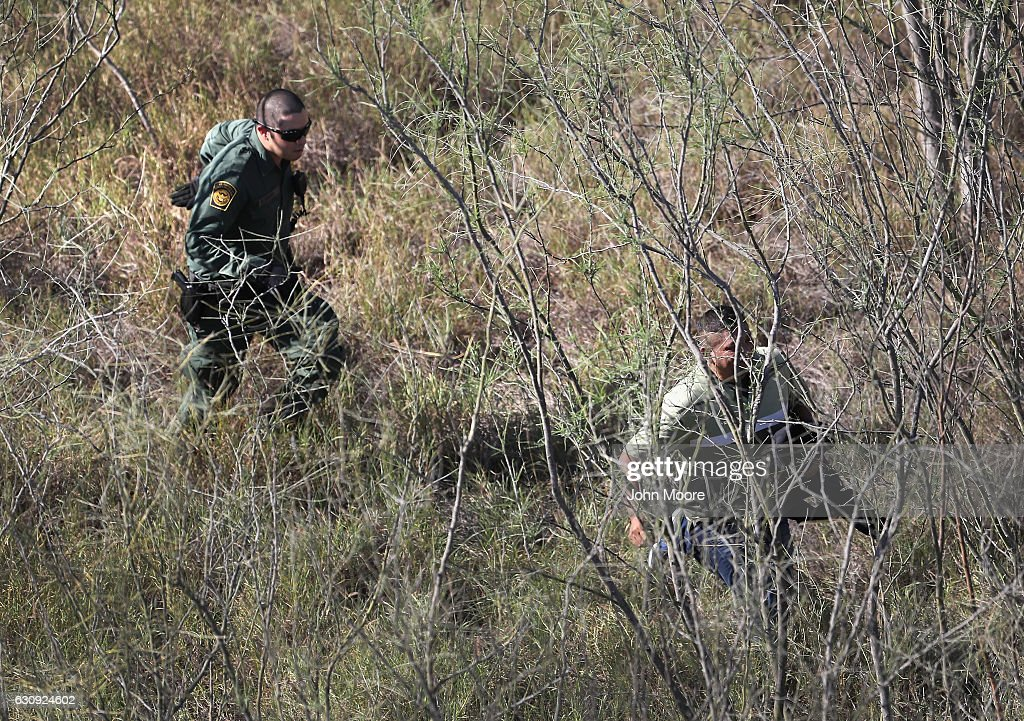 S. Border Patrol agent chases an undocumented immigrant in thick brush near the U.S.-Mexico border on January 3, 2017 near Mission, Texas. Thousands of undocumented immigrants are surging across the border ahead of the inauguration of President-elect Donald Trump, who campaigned on strengthening border security.