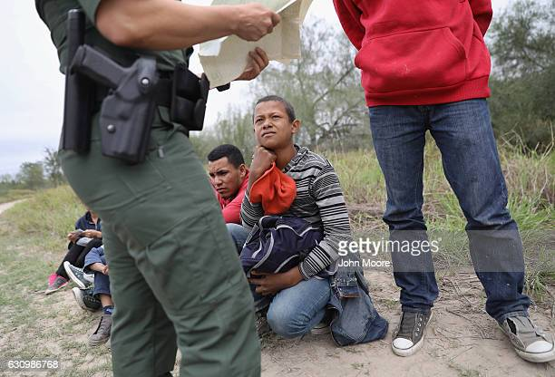 S Border Patrol agent checks birth certificates while taking Central American immigrants into custody on January 4 2017 near McAllen Texas Thousands...