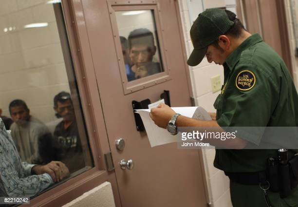 S Border Patrol agent checks the names of detainees after they were caught crossing from Mexico into the United States August 7 2008 near Laredo...