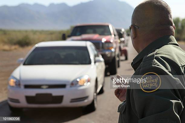 Border Patrol agent checks vehicles for illegal immigrants and contraband at a roadside checkpoint June 1 2010 near Sasabe Arizona During the 2009...